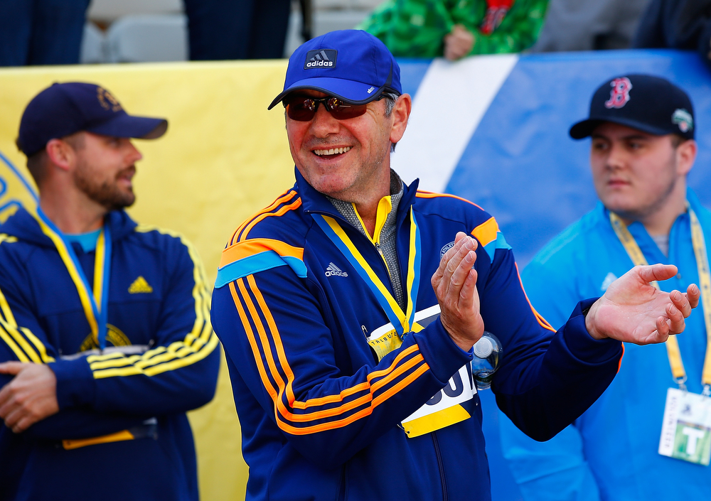 . Actor Kevin Spacey greets participants at the finish line of the B.A.A. Tribute Run on April 19, 2014 in Boston, Massachusetts.  (Photo by Jared Wickerham/Getty Images)