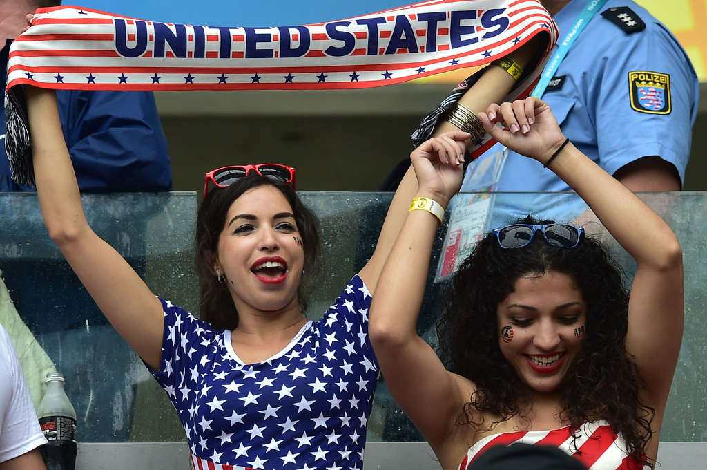 . US fans cheer during a Group G football match between US and Germany at the Pernambuco Arena in Recife during the 2014 FIFA World Cup on June 26, 2014. NELSON ALMEIDA/AFP/Getty Images
