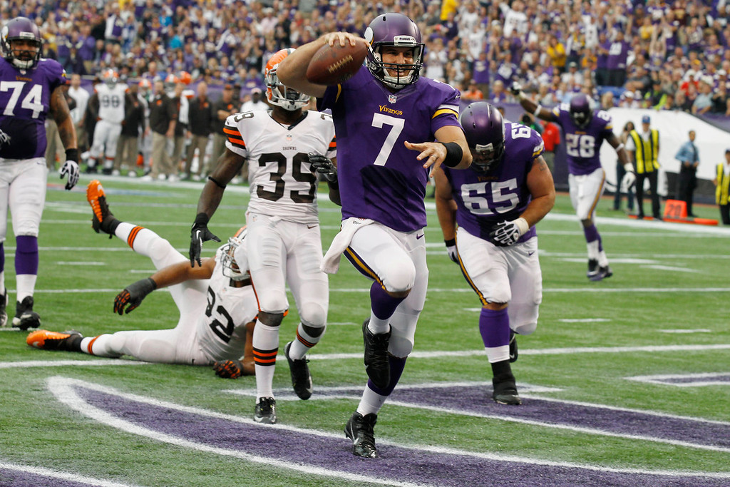 . Minnesota Vikings quarterback Christian Ponder (7) celebrates after scoring on a 6-yard touchdown run during the first half of an NFL football game against the Cleveland Browns Sunday, Sept. 22, 2013, in Minneapolis. (AP Photo/Ann Heisenfelt)