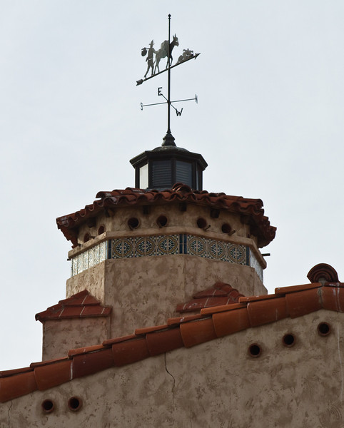 Scotty, his burro and the weather vane atop Scotty's castle.