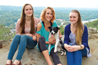 3 sisters with  a  puppy dog
