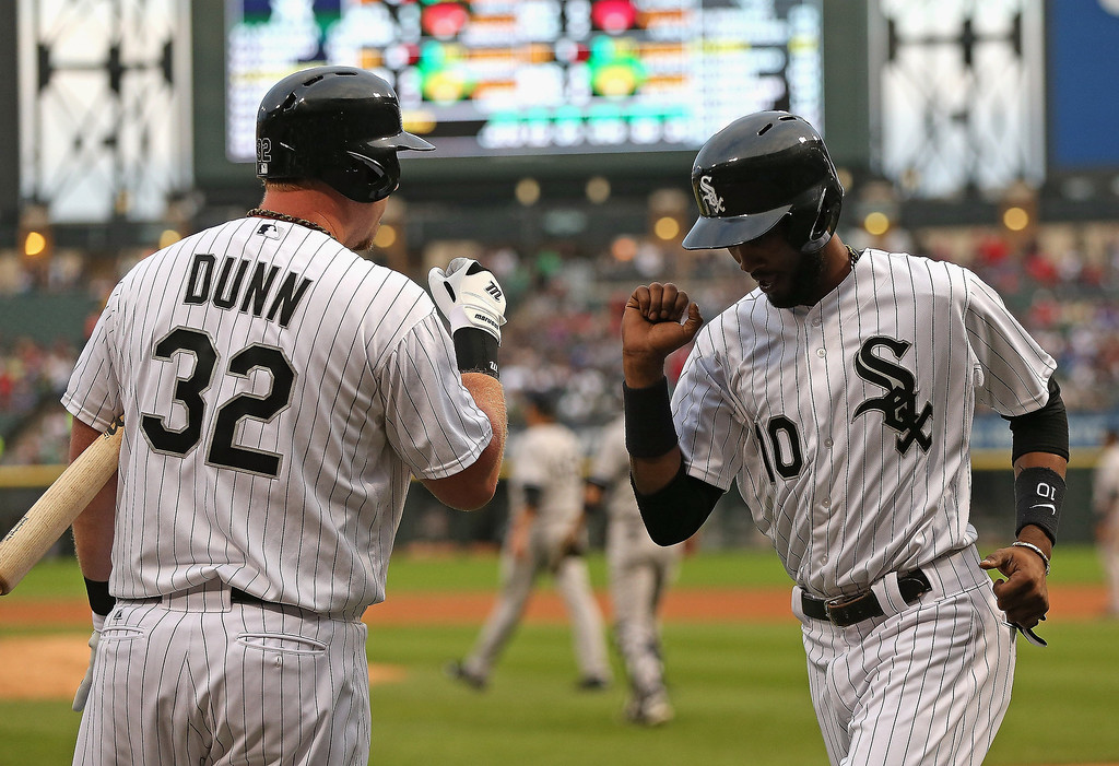 . Adam Dunn #32 of the Chicago White Sox congratulates teammate Alexei Ramirez #10 after Ramirez scored a run against the New York Yankees at U.S. Cellular Field on August 5, 2013 in Chicago, Illinois. (Photo by Jonathan Daniel/Getty Images)