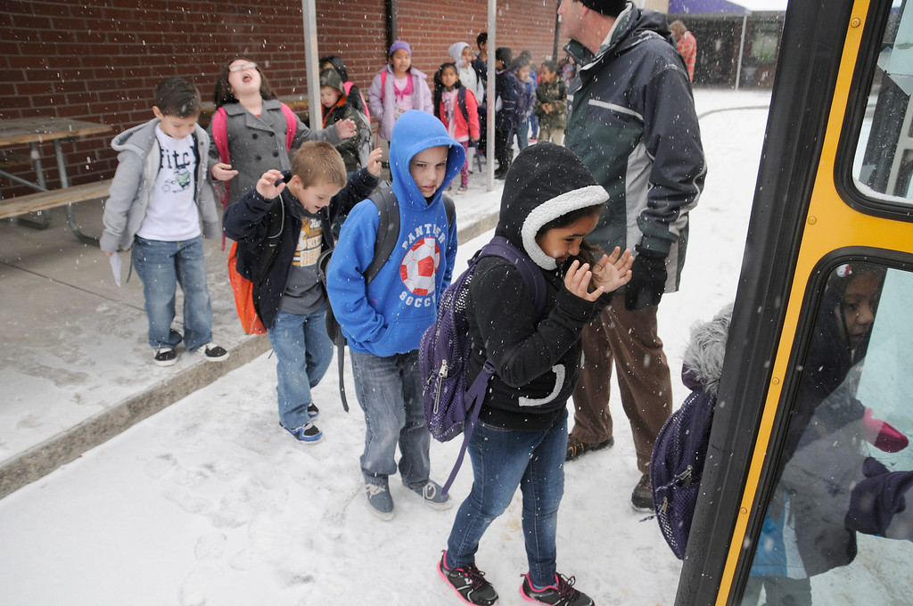 . Sevierville Primary School students load up as school is let out early due to snow in Sevierville, Tenn., Tuesday, Jan. 28, 2014.  Snowfall across East Tennessee has led several school districts to call off classes early. (AP Photo/The Mountain Press, Curt Habraken)