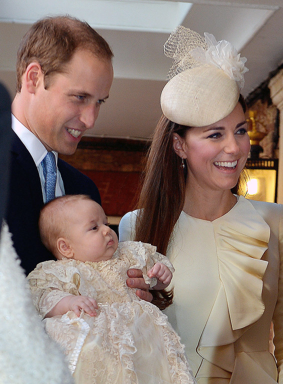 . Prince William, Duke of Cambridge and Catherine, Duchess of Cambridge talk to Queen Elizabeth II (not pictured) as they arrive, holding their son Prince George, at Chapel Royal in St James\'s Palace, ahead of the christening of the three month-old Prince George of Cambridge by the Archbishop of Canterbury on October 23, 2013 in London, England. (Photo by John Stillwell - WPA Pool /Getty Images)