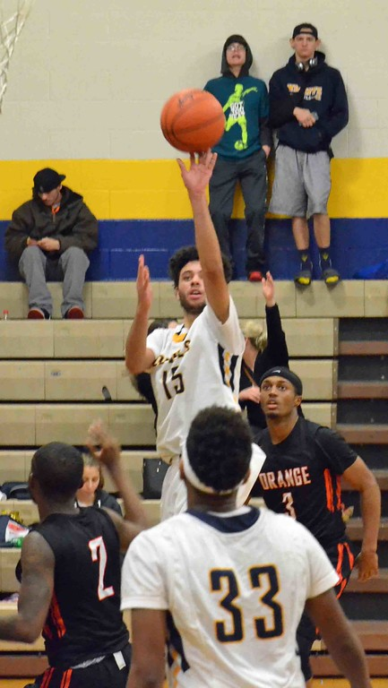 . Paul DiCicco - The News-Herald Wickliffe�s Jaysen Lewis rises up over an Orange defender for a jump shot in the second quarter.
