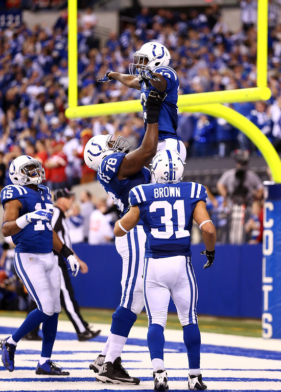 . INDIANAPOLIS, IN - JANUARY 04: Wide receiver T.Y. Hilton #13 of the Indianapolis Colts celebrates a fourth quarter touchdown with teammates against the Kansas City Chiefs during a Wild Card Playoff game at Lucas Oil Stadium on January 4, 2014 in Indianapolis, Indiana.  (Photo by Andy Lyons/Getty Images)