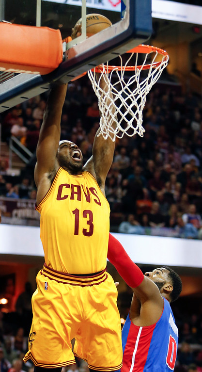 . Cleveland Cavaliers\' Tristan Thompson (13) goes up for a dunk against Detroit Pistons\' Andre Drummond during the first half of an NBA basketball game Friday, Nov. 18, 2016, in Cleveland. The Cavaliers won 104-81. (AP Photo/Ron Schwane)