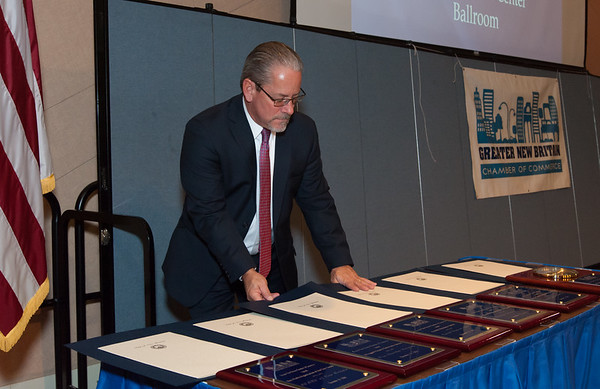 11/15/18 Wesley Bunnell   Staff The Greater New Britain Chamber of Commerce held their 105th Annual Meeting on Thursday night at CCSU. Chamber President Tim Stewart looks over the awards to be presented.