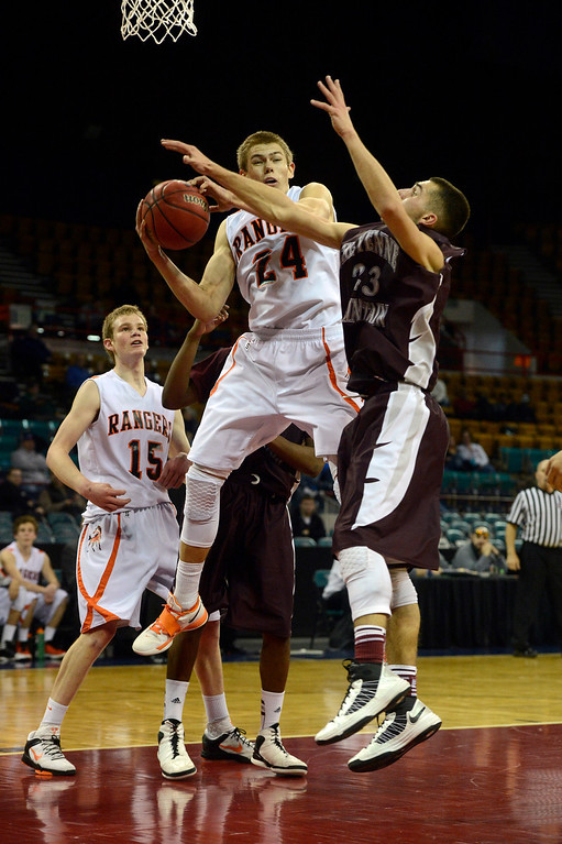 . DENVER, CO. - MARCH 9TH: Justin Smith, left, Lewis-Palmer, tries to get to the hoop against the defense of Ghassan Nehme, Cheyenne Mountain in the second half of their �Great Eight� game of the Colorado High School Basketball Championships at the Denver Coliseum, Saturday afternoon, March 9th, 2013. Lewis-Palmer won 66-49 to move on to the Final Four at the CU Events Center, March 15th, 2013. (Photo By Andy Cross/The Denver Post)