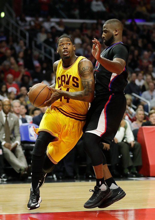 . Cleveland Cavaliers\' DeAndre Liggins, left, drives past Los Angeles Clippers\' Raymond Felton during the second half of an NBA basketball game Saturday, March 18, 2017, in Los Angeles. (AP Photo/Jae C. Hong)