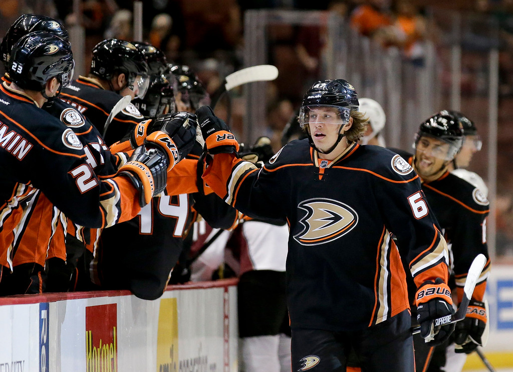 . Anaheim Ducks center Rickard Rakell celebrates his goal with teammates after scoring against the Colorado Avalanche during the first period of an NHL hockey preseason game in Anaheim, Calif., Monday, Sept. 22, 2014. (AP Photo/Chris Carlson)