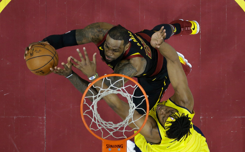 . Cleveland Cavaliers\' LeBron James, left, drives to the basket against Indiana Pacers\' Myles Turner in the first half of Game 7 of an NBA basketball first-round playoff series, Sunday, April 29, 2018, in Cleveland. The Cavaliers won 105-101. (AP Photo/Tony Dejak)
