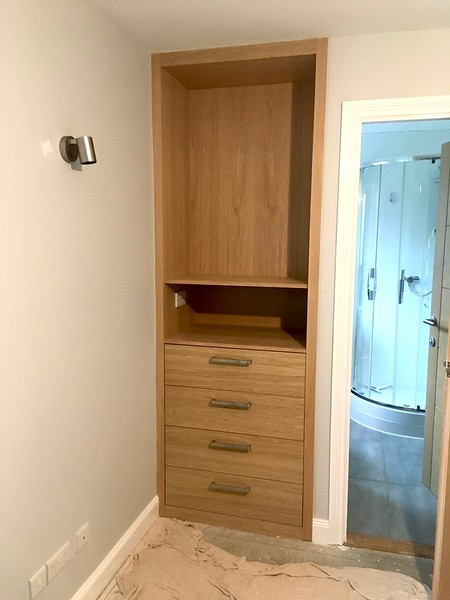 Unit surface finish applied and handles fitted, adjustable shelves left out as customer had not decided on fitting heights.