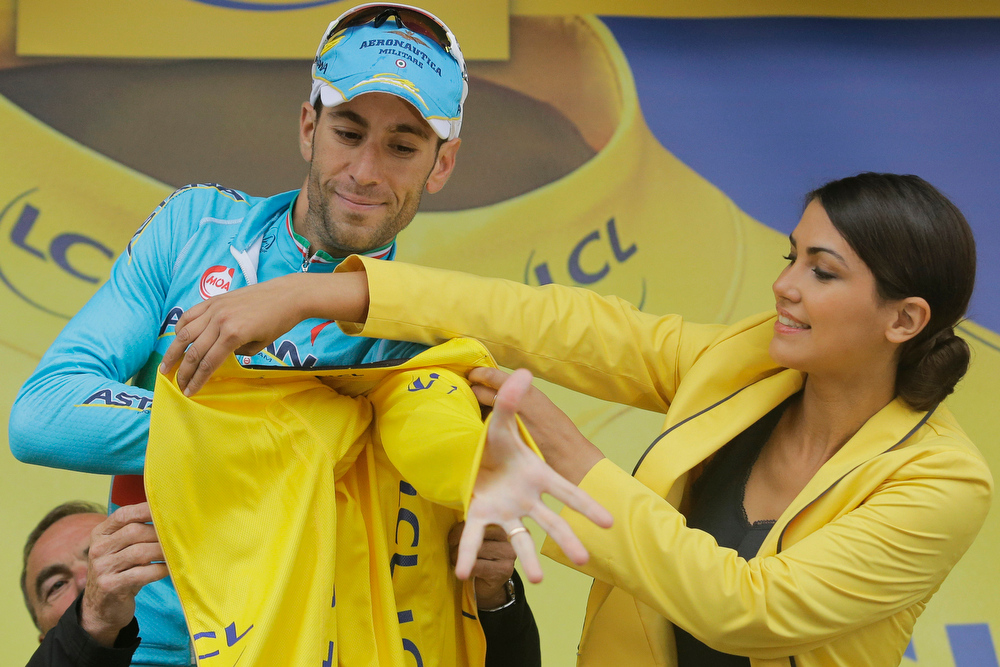. Italy\'s Vincenzo Nibali puts on the overall leader\'s yellow jersey on the podium of the eighth stage of the Tour de France cycling race over 161 kilometers (100 miles) with start in Tomblaine and finish in Gerardmer, France, Saturday, July 12, 2014. (AP Photo/Laurent Cipriani)