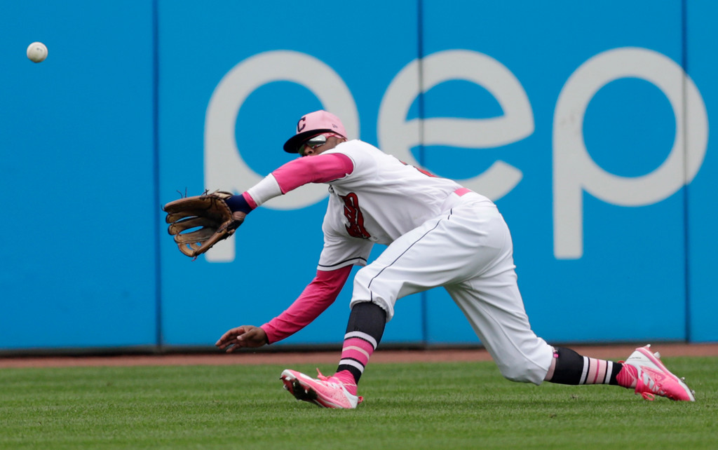 . Cleveland Indians\' Rajai Davis fields a ball hit by Kansas City Royals\' Lucas Duda in the eighth inning of a baseball game, Sunday, May 13, 2018, in Cleveland. Duda was out on the play. (AP Photo/Tony Dejak)