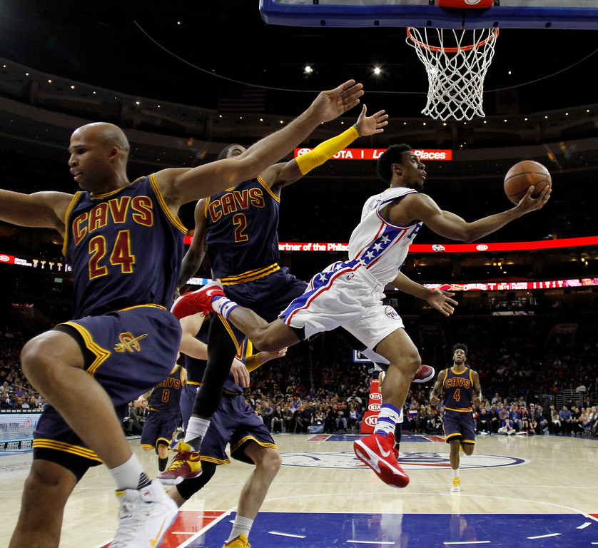 . Philadelphia 76ers\' Ish Smith (1) goes up for a shot against Cleveland Cavaliers\' Kyrie Irving (2) and Richard Jefferson (24) during the first half of an NBA basketball game, Sunday, Jan. 10, 2016, in Philadelphia. Cleveland won 95-85. (AP Photo/Matt Slocum)