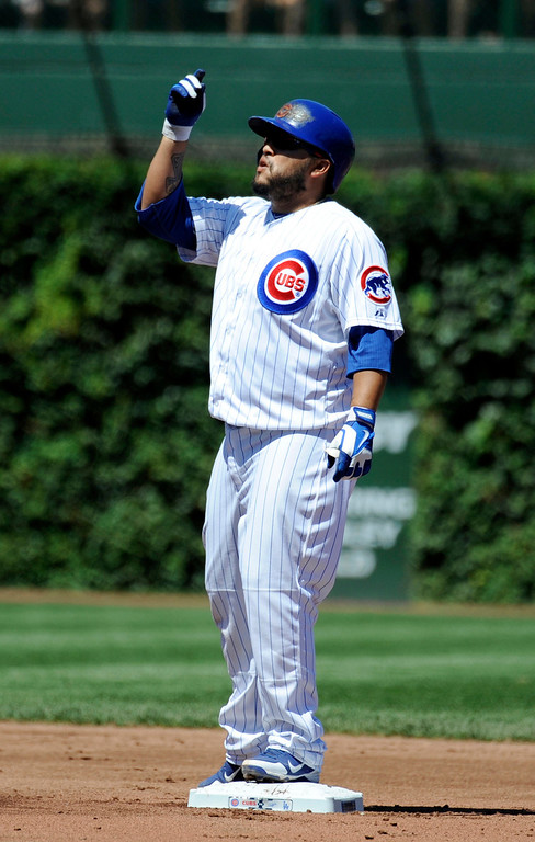 . Chicago Cubs\' Dioner Navarro reacts after getting a hit during their 1-0 loss to the Los Angeles Dodgers in a baseball game, Sunday, Aug. 4, 2013, in Chicago. (AP Photo/Joe Raymond)