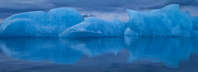 Iceberg reflecting in Jokulsarlon lagoon, Iceland