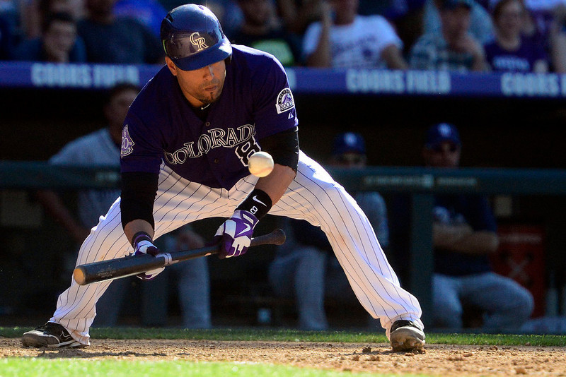 . DENVER, CO - JUNE 9: Colorado Rockies catcher Yorvit Torrealba (8) cannot lay down a bunt against the San Diego Padres during the Rockies\' 8-7 10-inning win in Denver. The Colorado Rockies hosted the San Diego Padres. (Photo by AAron Ontiveroz/The Denver Post)