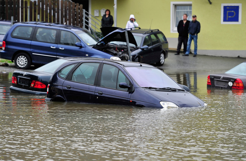 . Parked cars are flooded by the rising Danube river in the historic city center on June 3, 2013 in Passau, Germany. Heavy rains are pounding southern and eastern Germany, causing wide-spread flooding and ruining crops. At least two people are missing and feared dead in what is evolving into the most serious flood levels since the so-called 100-year flood of 2002. Portions of Austria and the Czech Republic are also inundated.  (Photo by Lennart Preiss/Getty Images)