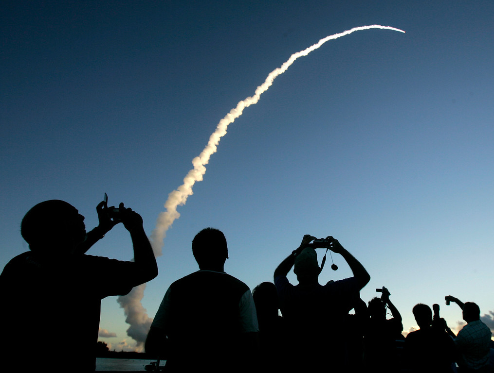 . Spectators at Jetty Park pier watch as a Delta II rocket with the Dawn spacecraft aboard, lifts off from the Cape Canaveral Air Force Station in Cape Canaveral, Fla., Thursday, Sept. 27, 2007. NASA\'s Dawn spacecraft rocketed away toward an unprecedented double encounter in the asteroid belt between Mars and Jupiter. (AP Photo/John Raoux)