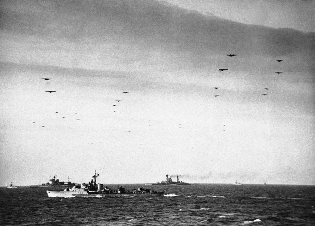 . Glider borne troops crossing the Channel ships of the Royal Navy on June 6, 1944. In the background are the battleships Warspite and Ramillies. (AP Photo)