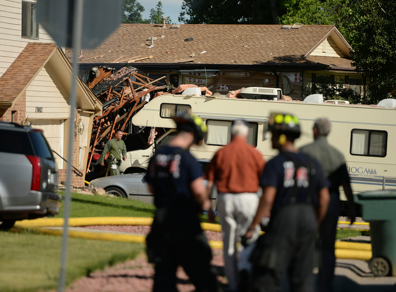 . Authorities responded to the scene of a house fire following an explosion at 13145 Monroe Drive in Thornton Thursday afternoon, June 19, 2014. One person that was thought to be in the home is missing.  (Photo by Karl Gehring/The Denver Post)