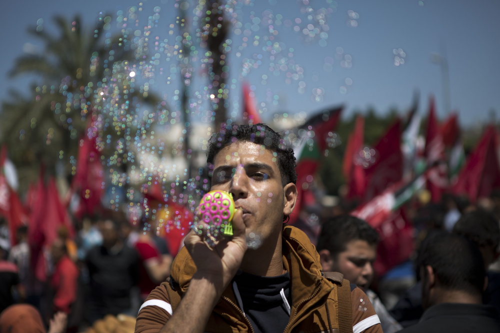 . Palestinian workers take part in a May Day rally, on May 1, 2014 in Gaza City. (MOHAMMED ABED/AFP/Getty Images)