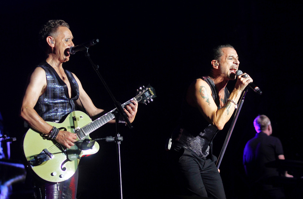 . Depeche Mode\'s Martin Gore, left, and Dave Gahan perform on Day 1 of the 2013 Austin City Limits Music Festival at Zilker Park on Friday, Oct. 4, 2013 in Austin, Texas. (Photo by Jack Plunkett/Invision/AP)