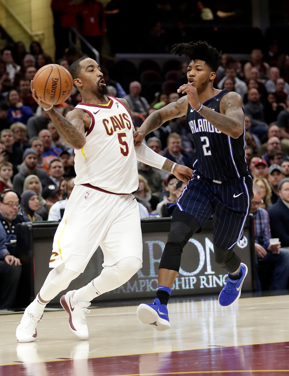 . Cleveland Cavaliers\' JR Smith (5) looks to pass against Orlando Magic\'s Elfrid Payton (2) in the first half of an NBA basketball game, Thursday, Jan. 18, 2018, in Cleveland. (AP Photo/Tony Dejak)