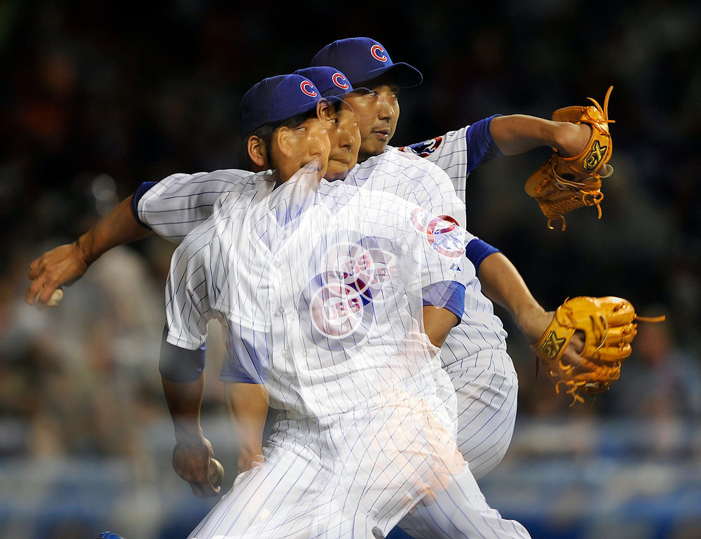 . Chicago Cubs\' Kyuji Fujikawa pitches against the Colorado Rockies during the eighth inning of a baseball game Monday, May 13, 2013, in Chicago. (AP Photo/Jim Prisching)