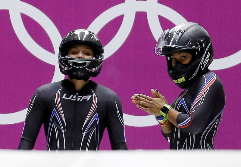 . The team from the United States USA-3, piloted by Jazmine Fenlator with brakeman Lolo Jones, left, prepare to start their first run during the women\'s two-man bobsled competition at the 2014 Winter Olympics, Tuesday, Feb. 18, 2014, in Krasnaya Polyana, Russia. (AP Photo/Natacha Pisarenko)