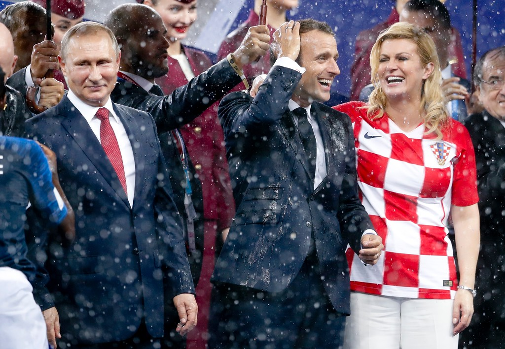 . From left, Russian President Vladimir Putin, French President Emmanuel Macron and Croatian President Kolinda Grabar-Kitarovic attend the award ceremony at the end of the final match between France and Croatia at the 2018 soccer World Cup in the Luzhniki Stadium in Moscow, Russia, Sunday, July 15, 2018. France won 4-2. (AP Photo/Petr David Josek)