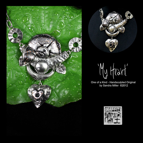 """MY HEART-   CLICK HERE TO VIEW VIDEO DESCRIPTION IN A NEW WINDOW  My heart is another one of my new designs inspired by some of my jewelry treasures I brought home from Istanbul Turkey  The main part of the necklace consists of little heart charms and a heart-shaped centerpiece dangle, suspended from a hinged crescent.  The gorgeous silver chow is hand sculpted from polymer clay, and finished over the surface with real Silverleaf which I then crackled to give it a very old world appearance  Her little paw drapes over the edge of the crescent shaped centerpiece  Despite her larger size , this piece is extremely lightweight and airy to wear  This is one of those designs that makes a jaw dropping statement wherever you go. Dressed up or down it doesn't matter ....she goes just as beautifully with that little black dresses she does jeans and a T-shirt.  A must for the 2012 CCCI National  CENTRAL PENDANT MEASURES   3 x 2  without the dangles 4""""  IS THE TOTAL LENGTH OF PENDANT SECTIONS Silver chain adjusts to 17"""" but let me know if you want longer."""