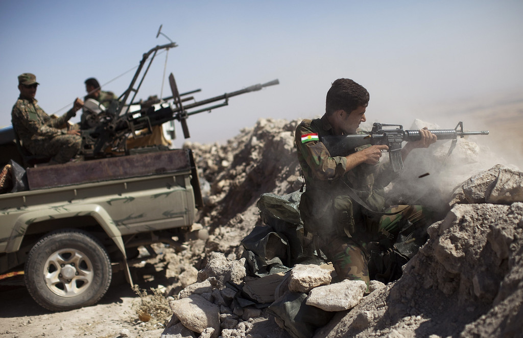 . An Iraqi Kurdish Peshmerga fighter fires at Islamic-State (IS) militant positions, from his position on the top of Mount Zardak, a strategic point taken 3 days ago, about 25  kilometres east of Mosul on September 9,2014. Kurdish forces in the north have been bolstered by US strikes and took control of Mount Zardak, a strategic site that provides a commanding view of the surrounding area, a senior US officer said. AFP PHOTO/ JM LOPEZJM LOPEZ/AFP/Getty Images