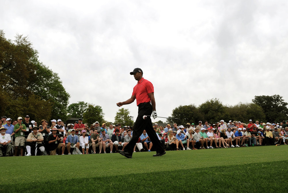 Description of . Tigers Woods of the US walks down the fairway during the final round of the 77th Masters golf tournament at Augusta National Golf Club on April 14, 2013 in Augusta, Georgia.  JEWEL SAMAD/AFP/Getty Images