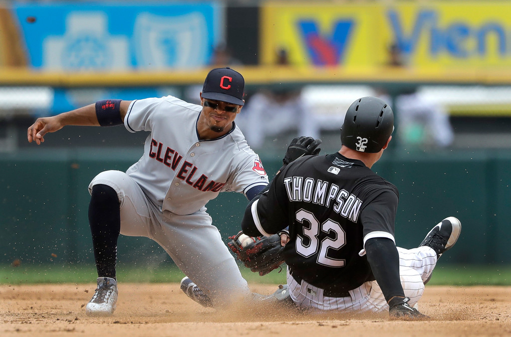 . Cleveland Indians shortstop Francisco Lindor, left, tags out Chicago White Sox\'s Trayce Thompson trying to steal second during the fifth inning of a baseball game Thursday, June 14, 2018, in Chicago. (AP Photo/Charles Rex Arbogast)
