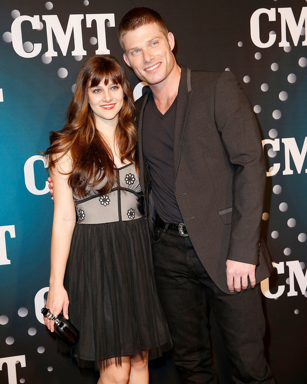 ". Actor Chris Carmack, right, of ABC\'s ""Nashville\"" and actress producer Aubrey Peeples pose on the red carpet at the CMT \""Artists of the Year\"" event at Bridgestone Arena, on Tuesday, December 3, 2013, in Nashville, Tenn. (Photo by Donn Jones/Invision/AP)"