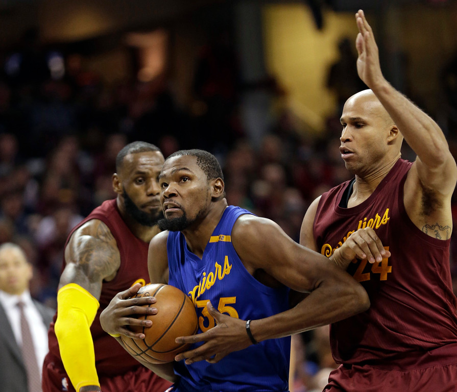 . Golden State Warriors\' Kevin Durant, left, drives to the basket against Cleveland Cavaliers\' Richard Jefferson in the second half of an NBA basketball game, Sunday, Dec. 25, 2016, in Cleveland. The Cavaliers won 109-108. (AP Photo/Tony Dejak)