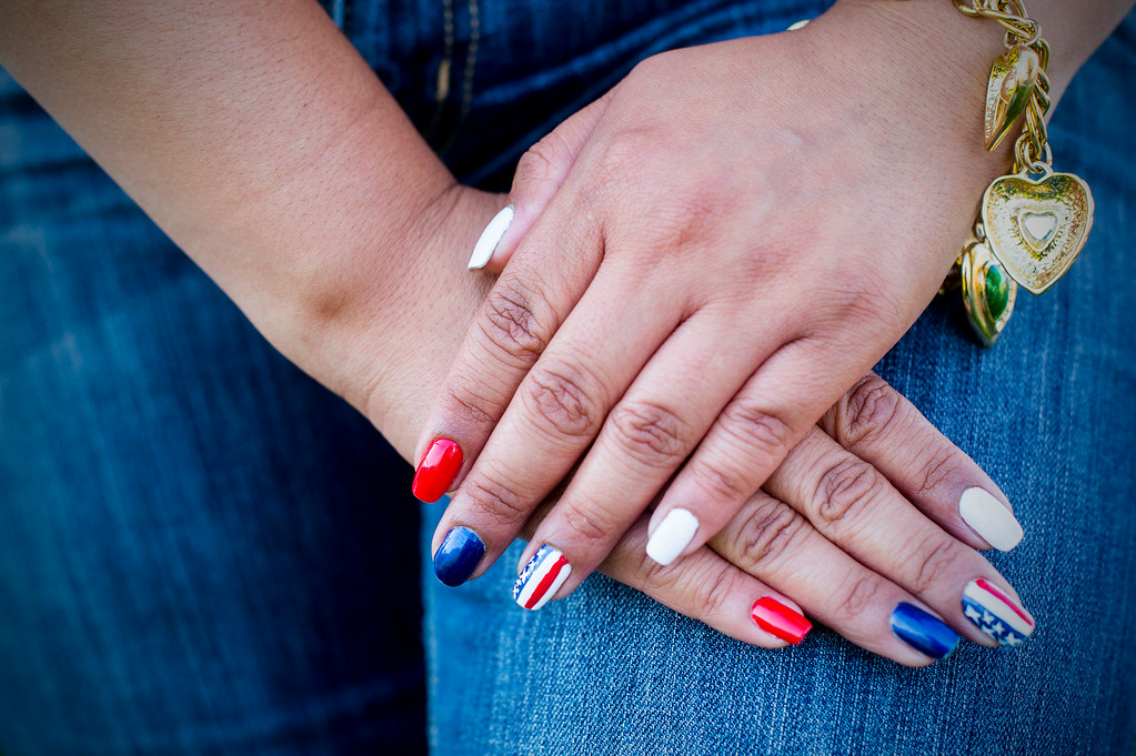 . Hashmat Guerra, of Eagle Rock, wears patriotic nail polish as she waits for Americafest\'s annual fireworks show at the Rose Bowl in Pasadena Friday night, July 4, 2014. (Photo by Sarah Reingewirtz/Pasadena Star-News)