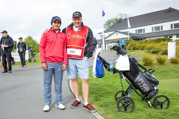 Kyaw Thet OO from Myanma with his caddy after hitting off the 1st tee on Day 1 of competition in the Asia-Pacific Amateur Championship tournament 2017 held at Royal Wellington Golf Club, in Heretaunga, Upper Hutt, New Zealand from 26 - 29 October 2017. Copyright John Mathews 2017.   www.megasportmedia.co.nz