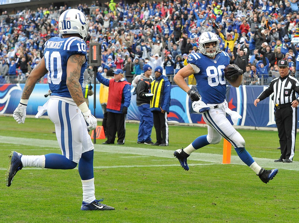 . NASHVILLE, TN - DECEMBER 28:  Coby Fleener #80 of the Indianapolis Colts scores a touchdown against the Tennessee Titans during the first quarter of a game at LP Field on December 28, 2014 in Nashville, Tennessee.  (Photo by Frederick Breedon/Getty Images)
