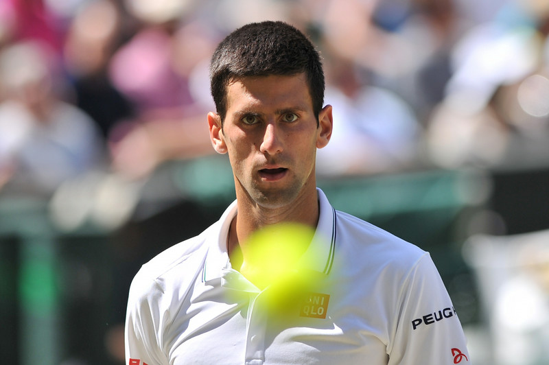 . Serbia\'s Novak Djokovic receives a ball before serving during his men\'s singles semi-final match against Bulgaria\'s Grigor Dimitrov on day 11 of  the 2014 Wimbledon Championships at The All England Tennis Club in Wimbledon, southwest London, on July 4, 2014. (GLYN KIRK/AFP/Getty Images)