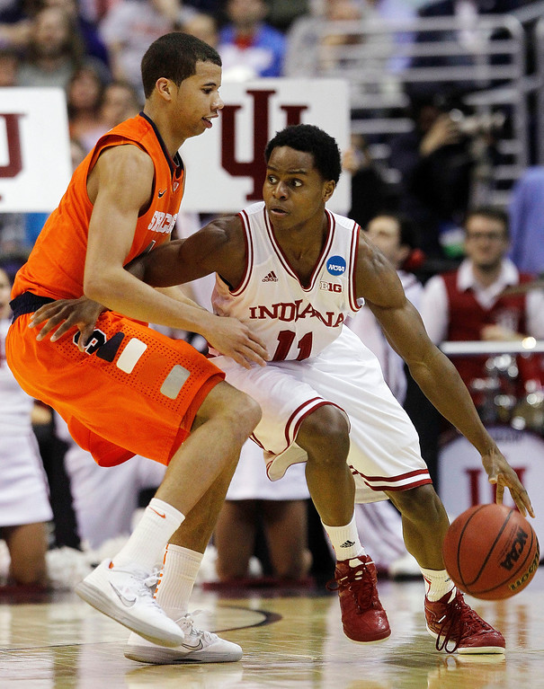 . Indiana guard Yogi Ferrell (11) drives around Syracuse guard Michael Carter-Williams, left, during the second half of an East Regional semifinal in the NCAA college basketball tournament, Thursday, March 28, 2013, in Washington. (AP Photo/Pablo Martinez Monsivais)