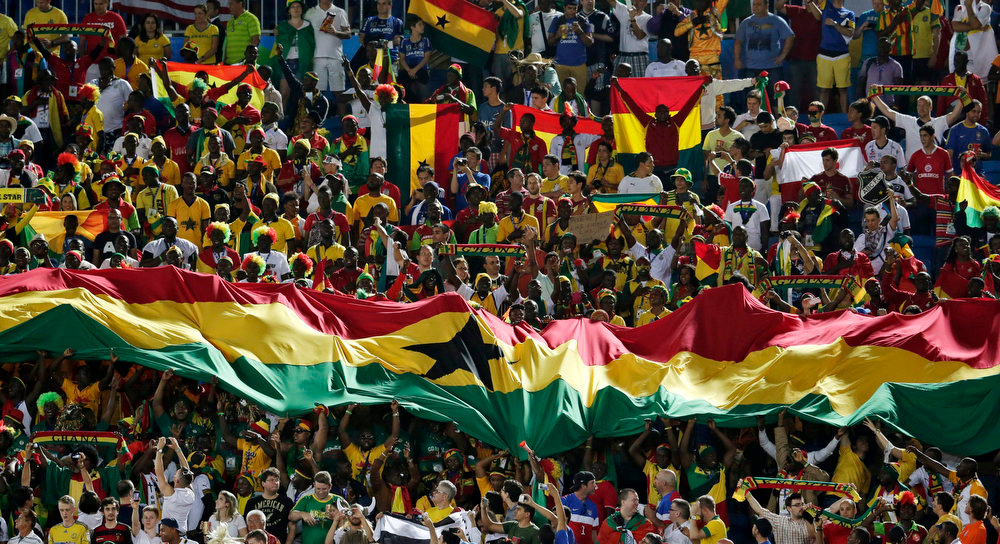 Description of . Fans from Ghana unfurl a banner in the stands before the group G World Cup soccer match between Ghana and the United States at the Arena das Dunas in Natal, Brazil, Monday, June 16, 2014.  (AP Photo/Petr David Josek)