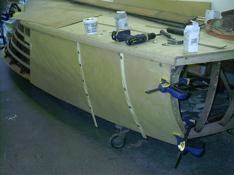 Plywood being fit to port side rear.