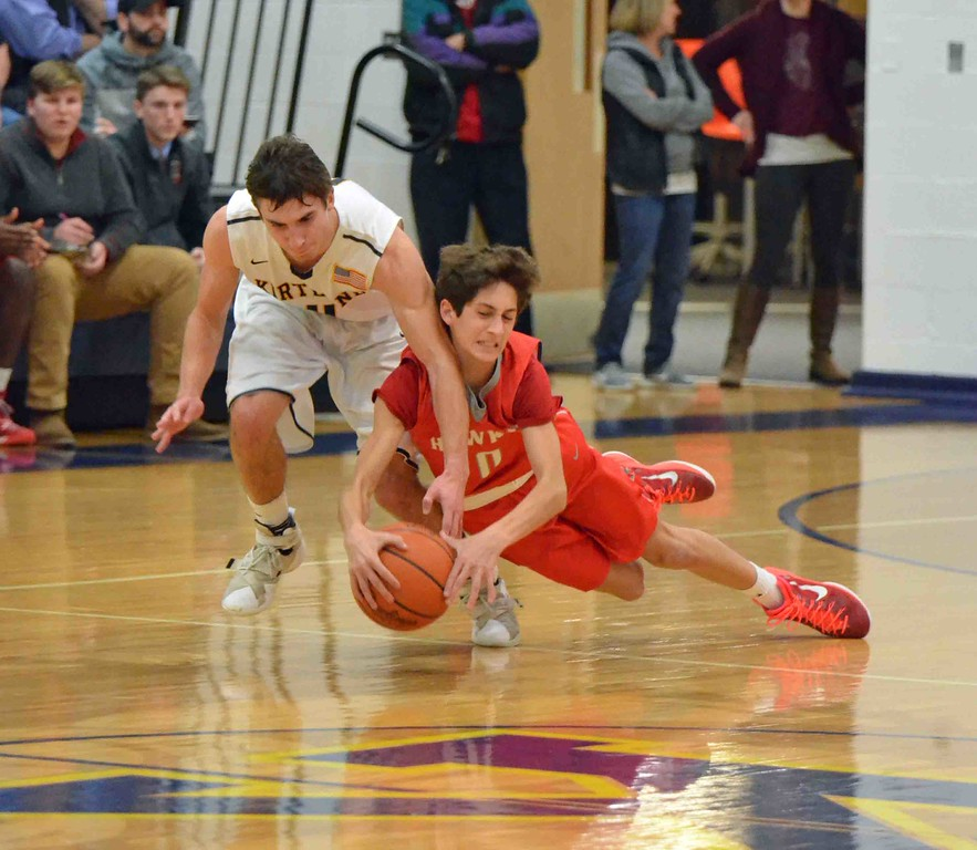 . Paul DiCicco - The News-Herald Hawken�s Charlie Ross dives for a loose ball.