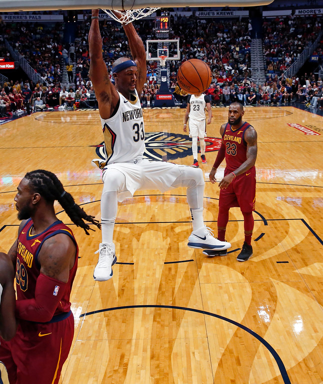 . New Orleans Pelicans forward Dante Cunningham (33) slam dunks in the first half of an NBA basketball game against the Cleveland Cavaliers in New Orleans, Saturday, Oct. 28, 2017. The Pelicans won 123-101. (AP Photo/Gerald Herbert)
