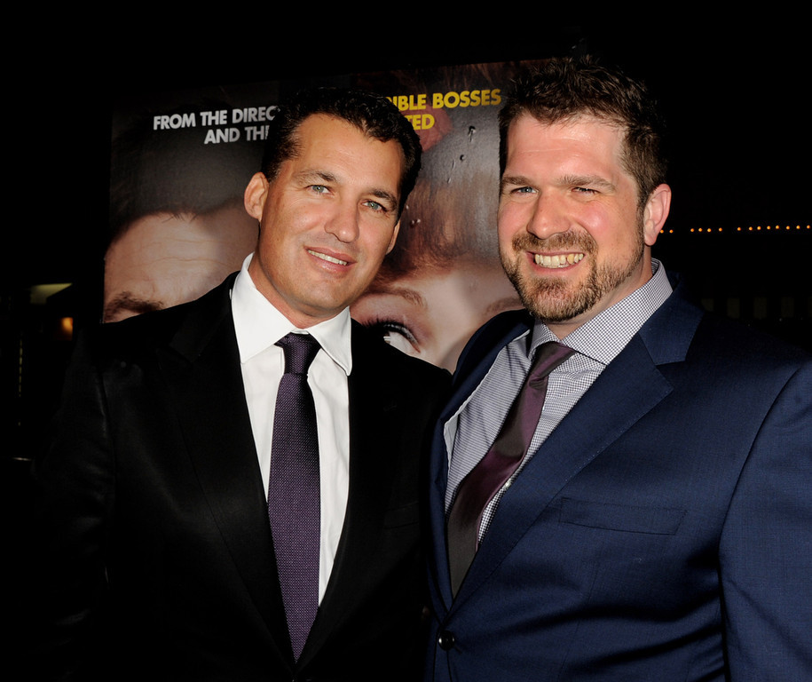 ". Producer Scott Stuber (L) and director Seth Gordon arrive at the premiere of Universal Pictures\' ""Identity Theft\"" at the Village Theatre on February 4, 2013 in Los Angeles, California.  (Photo by Kevin Winter/Getty Images)"