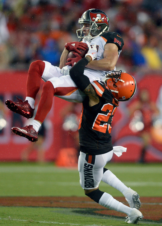 . Tampa Bay Buccaneers wide receiver Adam Humphries (10) is lifted off the field by Cleveland Browns cornerback Joe Haden (23) after a reception during the first quarter of an NFL preseason football game Saturday, Aug. 26, 2017, in Tampa, Fla. (AP Photo/Jason Behnken)
